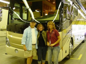 From left, John and Pat Goodwin and Christine Bahrke, Fleetwood RV VIP delivery specialist with the Goodwin's new American Coach