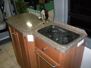 Granite Transformations countertop in Roadtrek Class B motorhome.