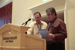 Bruce Hoster (left), president of Coast to Coast Resorts, goes over confernence materials with Mike Pournoury, president of Ocean Canyon Properties, Texarkana, Texas.