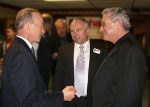 Indiana Gov. Mitch Daniels (left) meets with David Hoefer (right) a key investor in Earthbound RV LLC, and ??? Seybold, mayor of Marion, Ind., new home for the Hoosier RV company.,