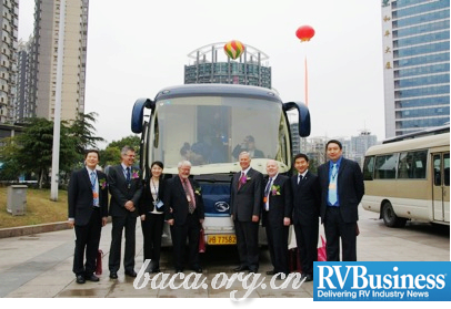 Members of an American RV delegation join their Chinese hosts in front of a Kinglong Coach at the trade show in Hangzhou, China.