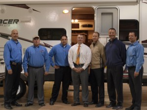 Officials from Tom Raper RV were given the keys to Prime Time Mfg.'s 1,000th unit recently. Pictured (l-r): Jim Leep, Ed unger, Scott Miller and Eddie Unger from Tim Raper RV, and Jason Gill, Jeff Rank and Chris Hermon from Prime Time.