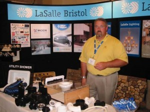 Brent Clark of Lasalle Bristol mans his company's booth at the Elkhart County Supplier Expo in Elkhart, Ind.