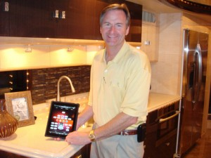 Frank Konigseder, co-owner of Liberty Coach, showcases the Apple iPad which will soon be integrated into every new coachs onboard electronics.  