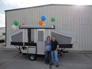 Heather and Chet Engler with their new Coleman camping trailer