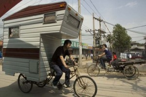Completely human powered, about half the size of a normal cab-over camper, and completely emission free, the Camper Bike is designed by Boston-based artist Kevin Cyr. The Camper Bike is both a fully functioning RV and the subject of a number of Cyrs amazing paintings.