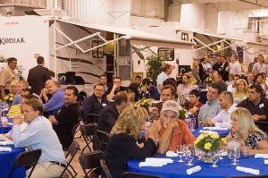 RV dealers listen to a band performing during an open house sponsored by Dutchmen Manufacturing Inc.