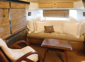 Linens on display inside Airstream trailer.