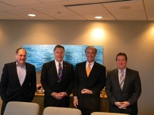 KOA's Jim Rogers (second from left) confers with Dirk Kempthorne (second from right) and Kempthorne staff members during a recent visit in Washington, d.C.
