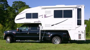 A pickup truck camper by Chalet RV Inc.