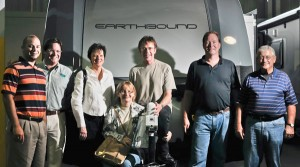 Deb and Mark Lindsay (center) are joined at Earthbound RV's Marion, Ind., facility by (l-r) Marion executives Jonathan Perez, Darren Reese and Janet Pearson, along with Earthbound Production Manager Craig Hardy and Dave Hoefer Sr., Earthbound's chairman and co-founder.