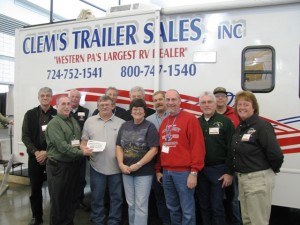 Shown in photo (front row, from left) are  Randy Giancola from Clenm's Trailer Sales, presenting to contest winners Michael and Janet Wolbert; Dennis Quigley of Kozy Rest Kampground in Harrisville, Tim Chilson of Brookdale Campground in Meadville and Tracy Czambel from Yogi Bear Mill Run. In the back row are Randy Work from Yogi Bear Mill Run, Ed Tanski of Buttercup Woodlands Campground in Renfrew, Rick Yeager from Rose Point Park in New Castle, Glenn Kleinfelter from Peaceful Valley Campground in West Sunbury, Mark Wineman from Kalyumet Camping & Cabins in Cook Forest and Jack May from Farma Family Campground in Greenville.