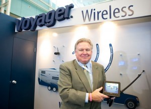 Pat McCullough, vice president of sales for Elkhart, Ind.-based ASA Electronics, showing the 5.6-inch LCD monitor of the company's Voyager wireless observation system.