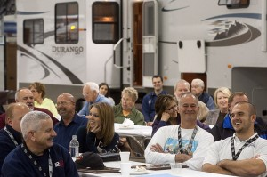 Dealer personnel enjoy comments from KZRV President Daryl Zook (not pictured) at the company's open house