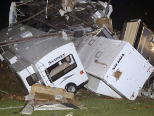 Travel trailers and motorhomes are piled on top of each other at Mayflower RV (AP photo)