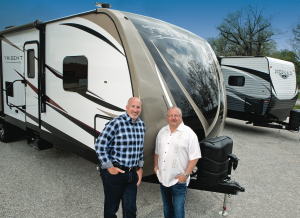 Don Emahiser, president of Skyline RV Group (left) with Brad Whitehead, director of sales and marketing, and the company's new Trident.