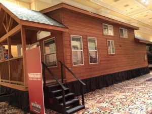 Cabin-style park model displayed at Dealer Days