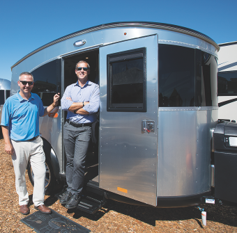 Airstream Inc. President Bob Wheeler (right) and Justin Humphreys, vice president of sales, with the Airstream Basecamp during September's Open House